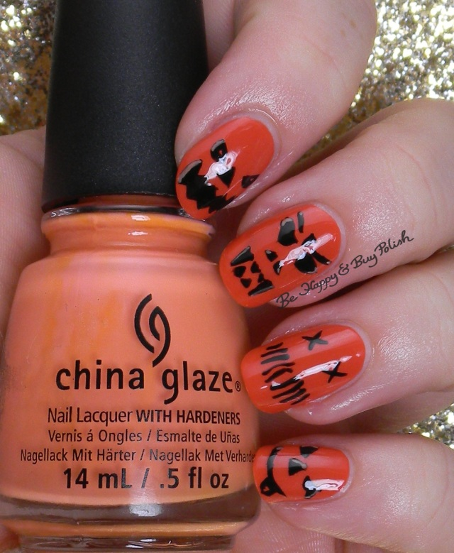 Halloween pumpkin faces manicure | Be Happy And Buy Polish