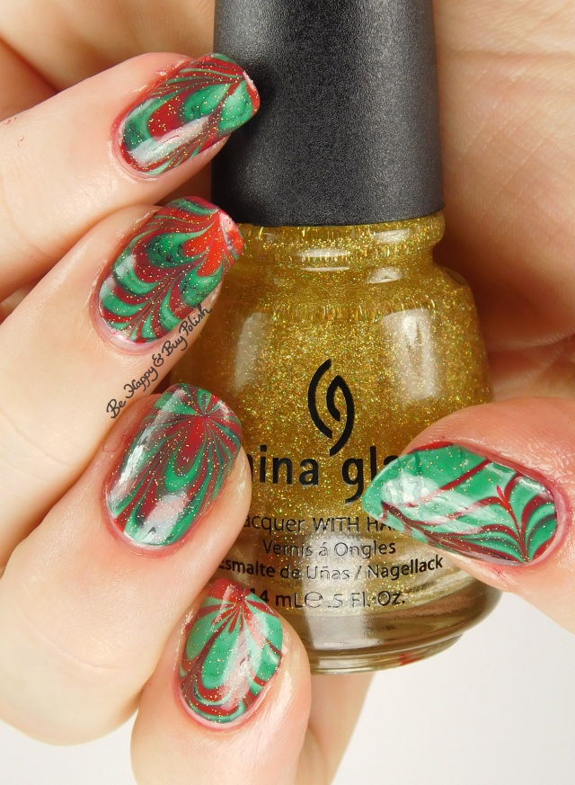 Christmas green + red watermarble with China Glaze Golden Enchantment hand pose | Be Happy And Buy Polish