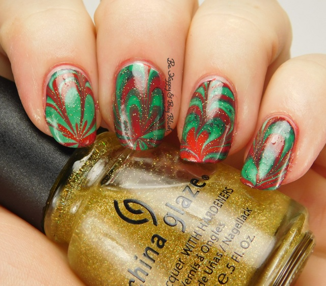 Christmas green + red watermarble with China Glaze Golden Enchantment side pose | Be Happy And Buy Polish