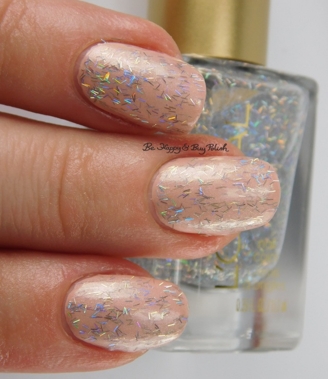 L'Oreal Gypsy Glitz over Peaceful Pink 3-finger pose, Bohemian Beauty nail polish | Be Happy And Buy Polish