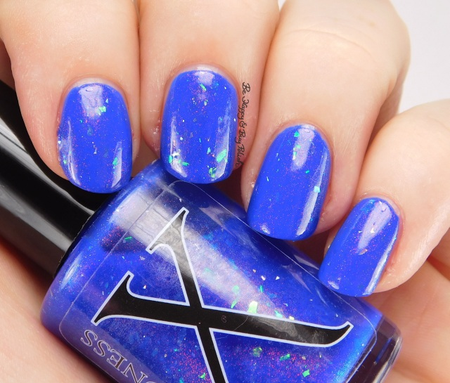 Baroness X Alhambra over Milani Blue Print side pose | Be Happy And Buy Polish