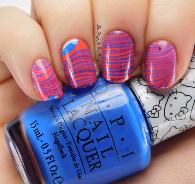 Hello Kitty OPI 5 Apples Tall + My Pal Joey right hand watermarble side pose | Be Happy And Buy Polish