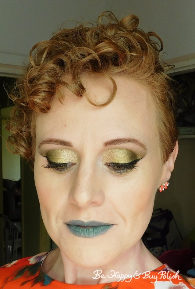 gold eyeshadow and green lipstick makeup with Saucebox Cosmetics, Juvia's Place, Marvel Infinity Eyeshadow | Be Happy And Buy Polish