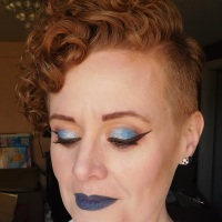 Blue eyeshadow and blue lipstick makeup look with Urban Decay, Coastal Scents, Hot Topic, and Makeup Revolution