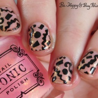 Glow in the Dark Confetti Manicure with Tonic Polish Snow Glowbe and Sinful Colors Black on Black